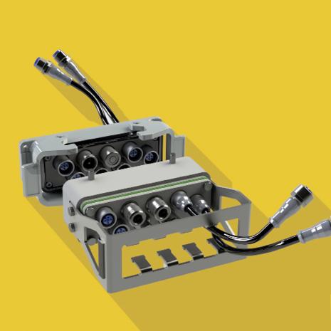 Eisele-Industriestecker können dank der Adaptiveinsätze mit Absperrfunktion auch Flüssigkeiten und Elektrik ohne Kurzschlussgefahr kombinieren.